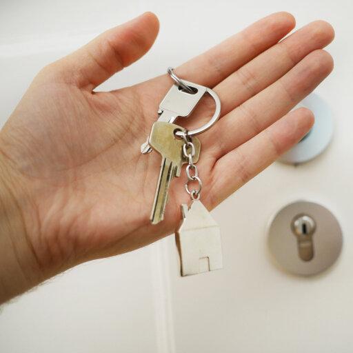 woman's hand holding keys